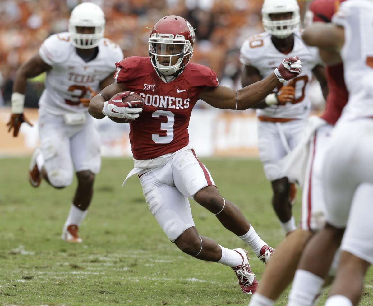 Oklahoma wide receiver Sterling Shepard (3) finds open field to run after a reception during the second half of an NCAA college football game against Texas at the Cotton Bowl, Saturday, Oct. 11, 2014, in Dallas. Oklahoma won 31-26. (AP Photo/LM Otero)