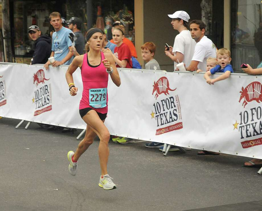 Women's race winner Lauren Robertson approaches the finish line during the Memorial Hermann 10 for Texas 10 mile road race starting and finishing at Market Street in The Woodlands. Over 2,800 runners participated in the run. Photo: David Hopper, Freelance / freelance