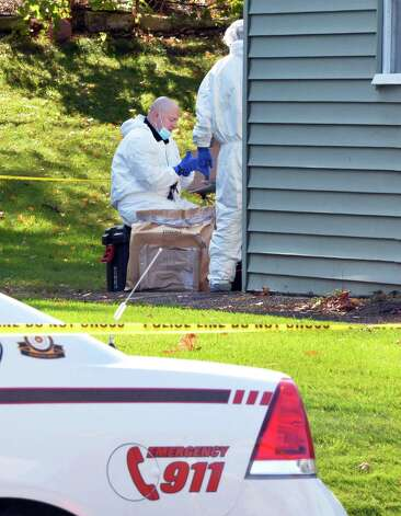 Investigators in the backyard of 1846 Western Ave. Saturday Oct. 11, 2014, scene of a quadruple murder earlier this week in Guilderland, NY.  (John Carl D'Annibale / Times Union) Photo: John Carl D'Annibale / 10029010A