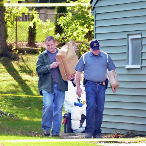 Investigators remove evidence from 1846 Western Ave. Saturday Oct. 11, 2014, scene of a quadruple murder earlier this week in Guilderland, NY.  (John Carl D'Annibale / Times Union) Photo: John Carl D'Annibale / 10029010A