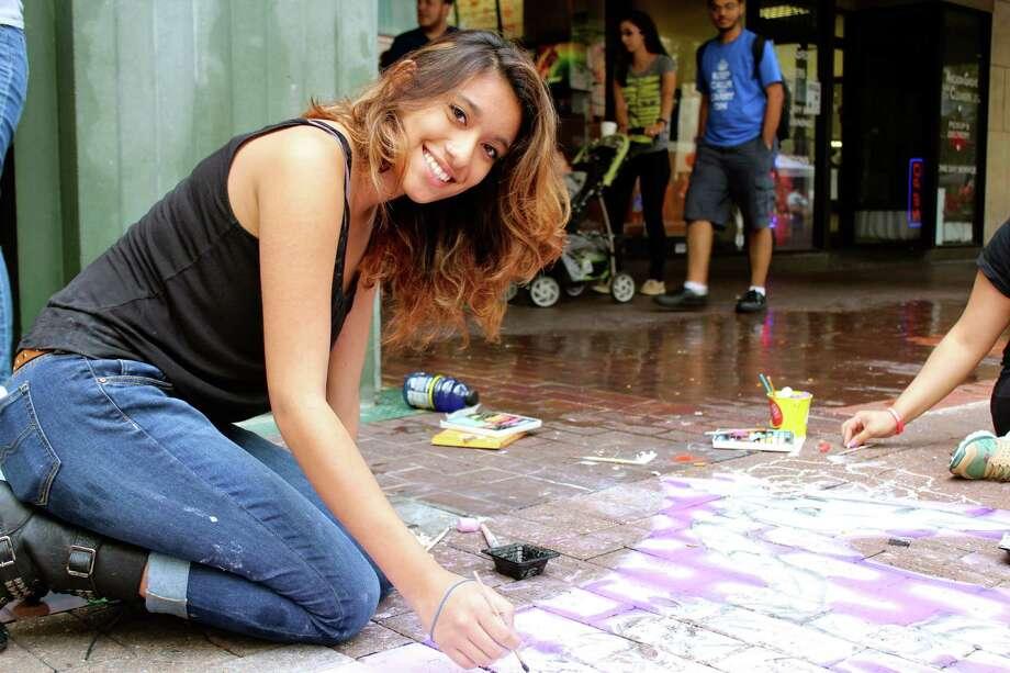 Residents hit downtown for Artpace San Antonio's Chalk It Up, a street gallery of sidewalk chalk art. Photo: By Yvonne Zamora, For MySA.com