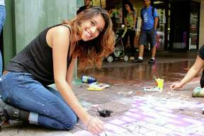 Residents hit downtown for Artpace San Antonio's Chalk It Up, a street gallery of sidewalk chalk art.