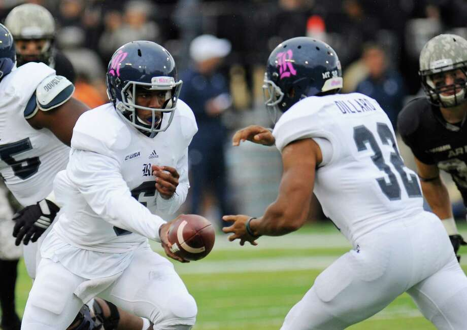 Rice quarterback Driphus Jackson (6) hands the ball to running back Darik Dillard (32) during the first half of an NCAA college football game against Rice, Saturday, Oct. 11, 2014, in West Point, N.Y. (AP Photo/Hans Pennink) Photo: Hans Pennink, Associated Press / FR58980 AP