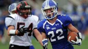 Darien's Hudson Hamill scores a touchdown Saturday, Oct. 11, 2014, during their game against Fairfield Warde at Darien High School in Darien, Conn.