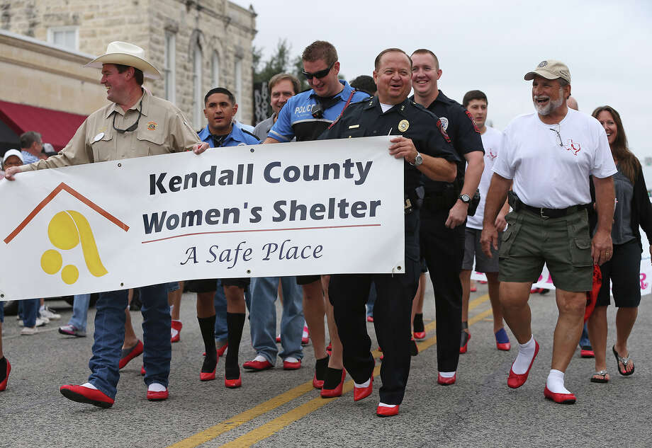 Participants not accustomed to wearing high heels may have gotten off to a wobbly start, but it was all for a good cause as the Kendall County Women's Shelter held its 4th Annual Walk a Mile in Her Shoes fundraiser Saturday in Boerne.The annual event also raises awareness of the issue and supports victims. This year, the shelter is focusing on teen-dating violence and its prevention. The organization's goal was to raise $20,000.Shown here is Kendall County Sheriff Al Auxier (left) and Boerne Police Chief Jim Kohler leading the parade. Photo: TOM REEL