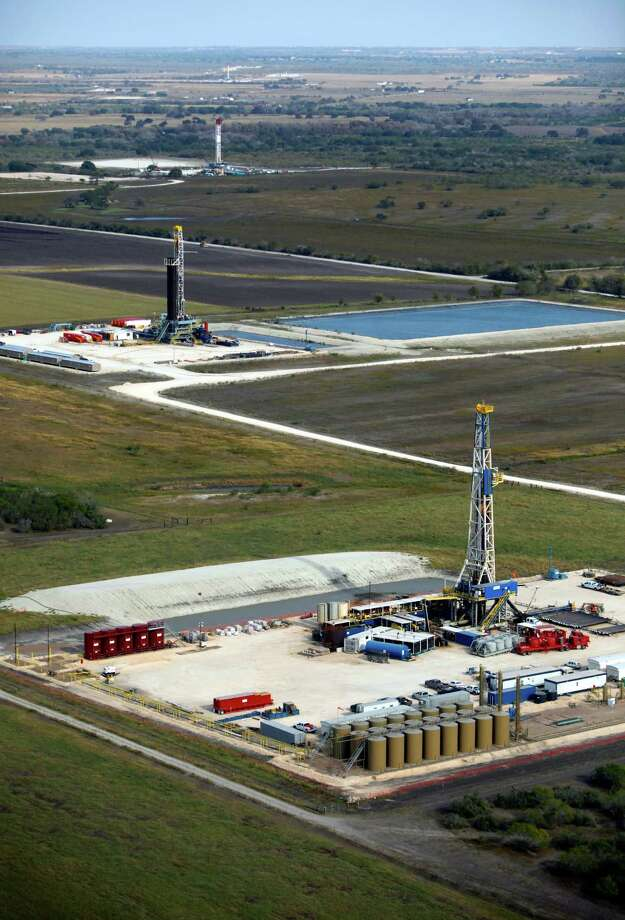 Drilling rigs in the Eagle Ford shale oil play are seen in this Friday Nov. 23, 2012 aerial photo. Photo: William Luther, Staff / © 2012 San Antonio Express-News