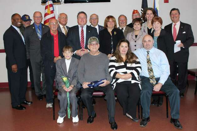 Albany County?s Honor-A-Vet program, held last week at the Joseph E. Zaloga American Legion Post, honored Owen J. Soraghan, a World War I soldier. He served in France and Belgium until wounded in action. Among those attending were, seated, family members Rose and Owen Jr., and Pat and Dave Thomas.