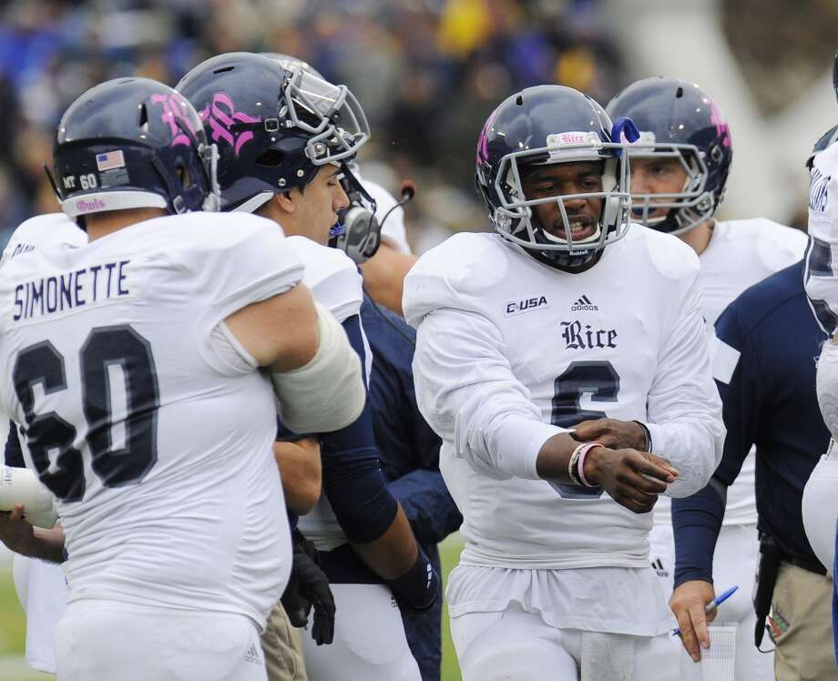 Rice quarterback Driphus Jackson (6) stands with teammates during a time out during the first half of an NCAA college football game against Army, Saturday, Oct. 11, 2014, in West Point, N.Y. (AP Photo/Hans Pennink) Photo: Hans Pennink, Associated Press