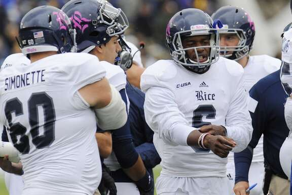 Rice quarterback Driphus Jackson (6) stands with teammates during a time out during the first half of an NCAA college football game against Army, Saturday, Oct. 11, 2014, in West Point, N.Y. (AP Photo/Hans Pennink)