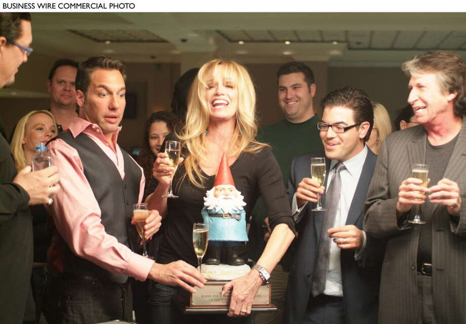 """From left to right: Thom Filicia, Susan Anton, Ed Miller, David Brenner. In a recent episode of Bravo's Emmy Award-Winning """"Queer Eye,"""" which premiered on Bravo on June 20, 2006, the Fab Five helped straight guy Ed Miller become a successful and well-known poker guru by having him teach one of them to compete in a Texas Hold 'em poker match at Caesars Palace against classic Vegas performers who included Susan Anton, Penn Jillette, David Brenner, and George Wallace. The Gnome was the winning prize, and is autographed by """"Queer Eye's"""" Fab Five as well as the Vegas performers featured in the episode. The winner of the """"Queer Eye"""" celebrity poker tournament was actress Susan Anton, who won $10,000 towards the charity of her choice, the New Orleans Habitat For Humanity. Proceeds from the auction will also be donated to New Orleans Habitat for Humanity. (Photo: Business Wire) / TRAVELOCITY"""