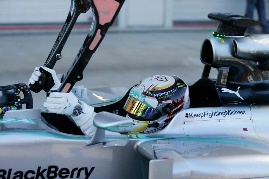 Mercedes driver Lewis Hamilton of Britain, removes a part of his car after setting the qualifying session at the 'Sochi Autodrom' Formula One circuit , in Sochi, Russia, Saturday, Oct. 11, 2014. The inaugural Russian GP will be held on Sunday in Sochi, the Black Sea resort that hosted this year's Winter Olympics. (AP Photo/Luca Bruno)  ORG XMIT: XLB136 Photo: Luca Bruno / AP