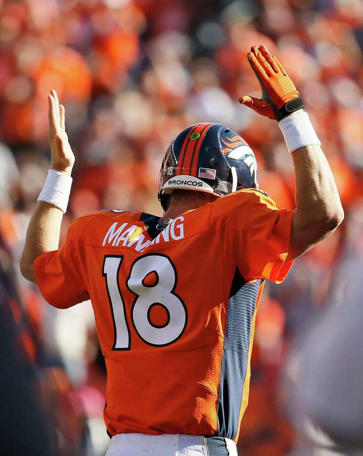 Denver Broncos quarterback Peyton Manning (18) signals a touchdown against the Arizona Cardinals during the second half of an NFL football game, Sunday, Oct. 5, 2014, in Denver. (AP Photo/Jack Dempsey)  ORG XMIT: COMY139 Photo: Jack Dempsey / FR42408 AP
