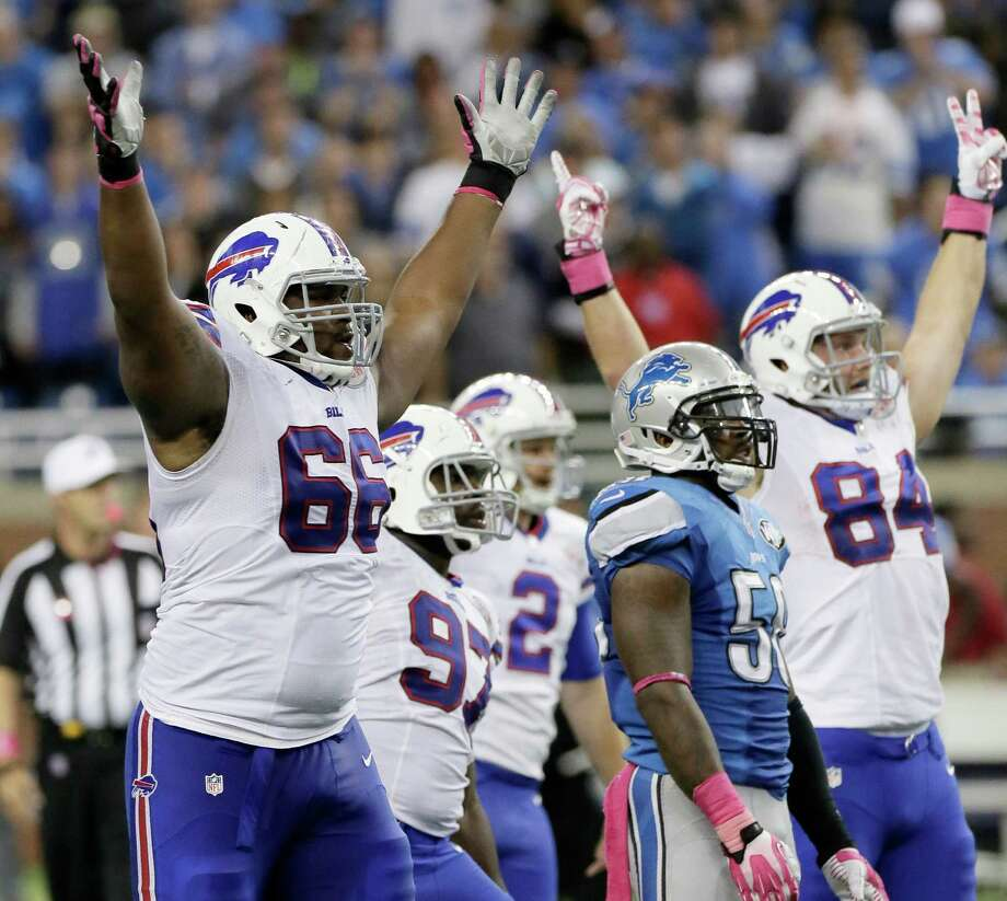 Buffalo Bills tackle Seantrel Henderson (66) celebrates as he watches a 58 -yard game-winning field goal in the fourth quarter of an NFL football game against the Detroit Lions Sunday, Oct. 5, 2014, in Detroit. The Bills defeated the Lions 17-14.(AP Photo/Duane Burleson) ORG XMIT: MITD130 Photo: Duane Burleson / FR38952 AP