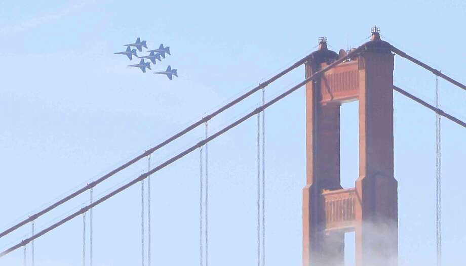 The Blue Angels fly past the Golden Gate Bridge last year. Photo: Jessica Christian, The Chronicle
