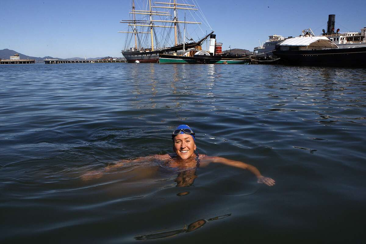 Adobe employee Kimberley Chambers gets ready to swim at the wharf in San Francisco, Calif., on Wednesday, October 1, 2014. She just swum Ireland?•s North Channel, the sixth person to complete the Oceans Seven challenge.