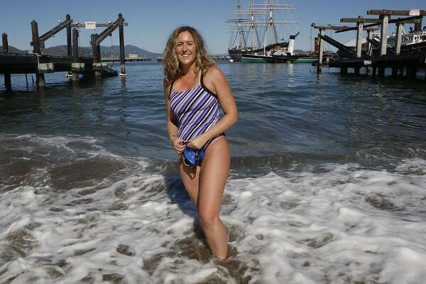 Adobe employee Kimberley Chambers gets ready to swim at the wharf in San Francisco, Calif., on Wednesday, October 1, 2014.  She just swum IrelandÕs North Channel,  the sixth person to complete the Oceans Seven challenge.