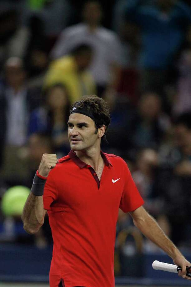 SHANGHAI, CHINA - OCTOBER 11: Roger Federer of Switzerland after the match against Novak Djokovic of Serbia during day 7 of the Shanghai Rolex Masters at Zi Zhong stadium on October 11, 2014 in Shanghai, China. (Photo by Kevin Lee/Getty Images) ORG XMIT: 515150795 Photo: Kevin Lee / 2014 Getty Images