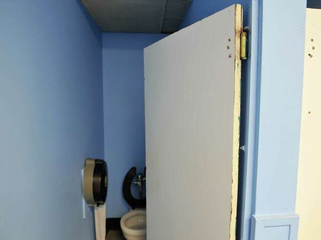 A view of the door to a bathroom stall in the boy's room at the Watervliet Civic Center on Wednesday, Oct. 1, 2014, in Watervliet, N.Y. The doors on the stalls will be replaced and that replacement is part of the improvements being made partially with a $2,500 grant from the Albany County Legislature's Special Projects Fund.   (Paul Buckowski / Times Union) Photo: Paul Buckowski / 00028838A