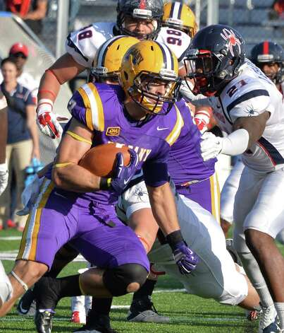 UAlbany QB Jake Meek breaks through the Richmond line during Saturday's game at Bob Ford Field Oct. 11, 2014, in Albany, NY.  (John Carl D'Annibale / Times Union) Photo: John Carl D'Annibale / 10028959A