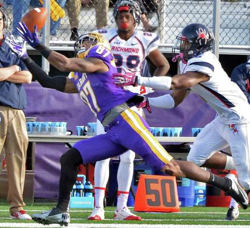 UAlbany 's #87 Cole King outruns Richmond's #9 Ayo Ogunniyi to complete a Will Fiacchi during Saturday's game at Bob Ford Field Oct. 11, 2014, in Albany, NY.  (John Carl D'Annibale / Times Union) Photo: John Carl D'Annibale / 10028959A
