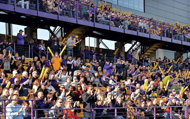 UAlbany fans cheer as their team scores against Richmond during Saturday's game at Bob Ford Field Oct. 11, 2014, in Albany, NY.  (John Carl D'Annibale / Times Union) Photo: John Carl D'Annibale / 10028959A