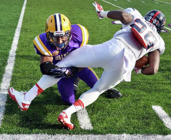 UAlbany 's #8 Jojo McClary, left, brings down Richmond's #29 Stephen Barnette during Saturday's game at Bob Ford Field Oct. 11, 2014, in Albany, NY.  (John Carl D'Annibale / Times Union) Photo: John Carl D'Annibale / 10028959A