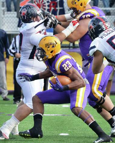 UAlbany's #23 Omar Osbourne looks for holes in the Richmond line during Saturday's game at Bob Ford Field Oct. 11, 2014, in Albany, NY.  (John Carl D'Annibale / Times Union) Photo: John Carl D'Annibale / 10028959A