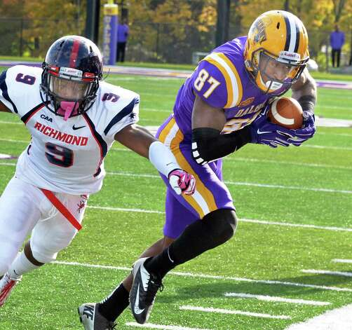 UAlbany 's #87 Cole King latches on to a Will Fiacchi pass as Richmond's #9 Ayo Ogunniyi closes in during Saturday's game at Bob Ford Field Oct. 11, 2014, in Albany, NY.  (John Carl D'Annibale / Times Union) Photo: John Carl D'Annibale / 10028959A