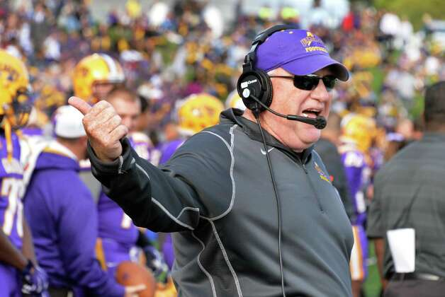 UAlbany head coach Greg Gattuso on his headphones during Saturday's game against Richmond at Bob Ford Field Oct. 11, 2014, in Albany, NY.  (John Carl D'Annibale / Times Union) Photo: John Carl D'Annibale / 10028959A