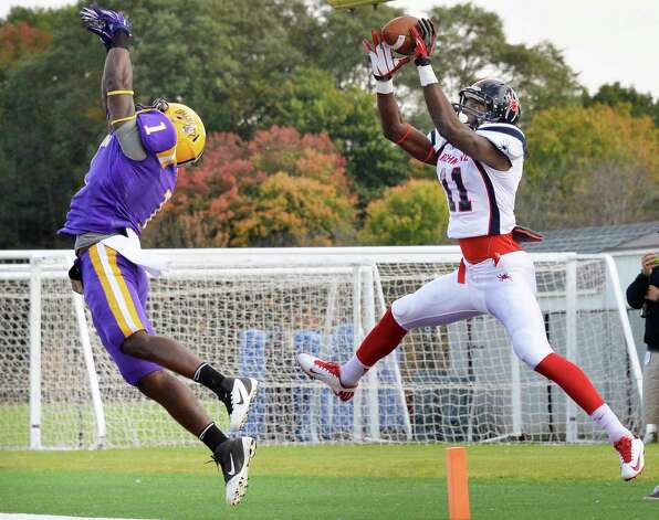 UAlbany's #1 TJ Idowu, left, can't stop Richmond's #11 Reggi Diggs from catching a TD pass during Saturday's game at Bob Ford Field Oct. 11, 2014, in Albany, NY.  (John Carl D'Annibale / Times Union) Photo: John Carl D'Annibale / 10028959A