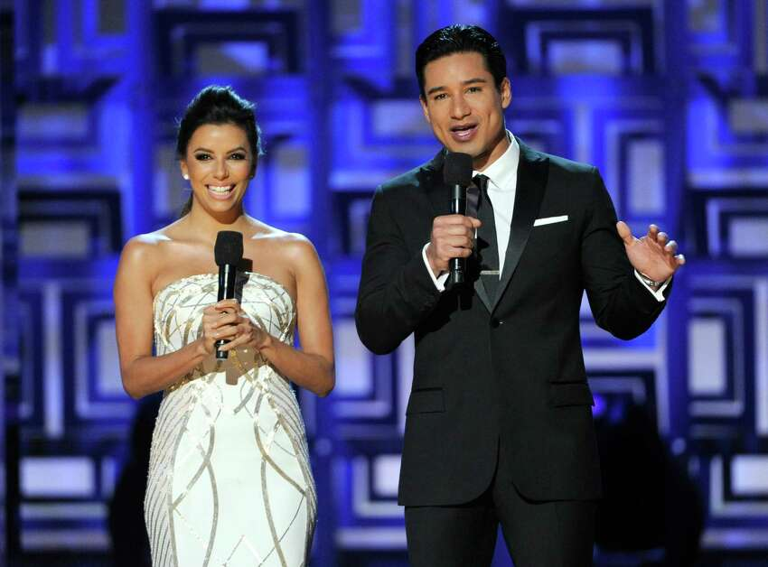 Hosts Eva Longoria, left, and Mario Lopez speak on stage at the NCLR ALMA Awards at the Pasadena Civic Auditorium on Friday, Oct. 10, 2014, in Pasadena, Calif. (Photo by Chris Pizzello/Invision/AP)