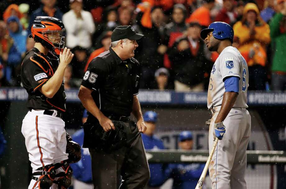 Kansas City Royals' Lorenzo Cain (6) argues a call with umpire Tim Timmons after striking out during seventh inning of Game 1 of the American League baseball championship series against the Baltimore Orioles Friday, Oct. 10, 2014, in Baltimore. (AP Photo/Alex Brandon)  ORG XMIT: ALCS229 Photo: Alex Brandon / AP