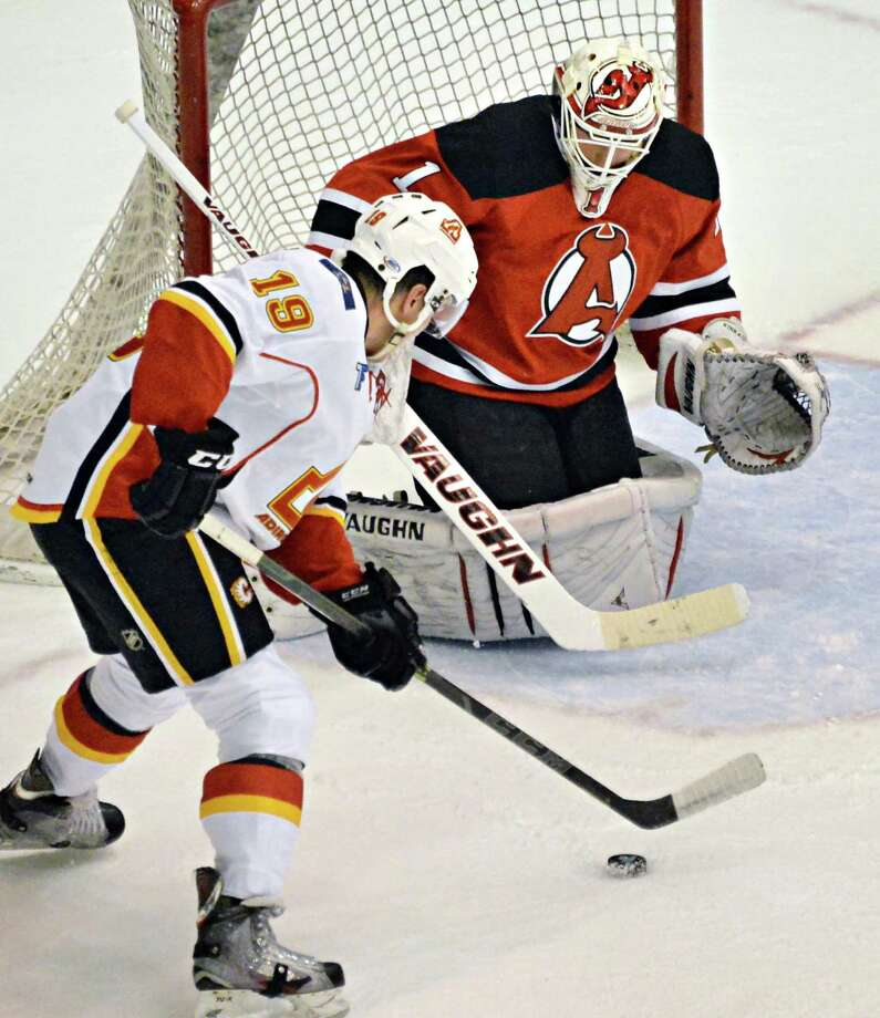 Adirondack Flames' #19 Michael Ferland's shot is blocked by Devils' goalie Keith Kinkaid, right, during Saturday's game at the Glens Falls Civic Center Oct. 11, 2014, in Glens Falls, NY.  .(John Carl D'Annibale / Times Union) Photo: John Carl D'Annibale / 10028978A