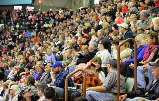 Hockey fans pack the Glens Falls Civic Center as the Adirondack Flames play their franchise opener against the Albany Devil's Saturday Oct. 11, 2014, in Glens Falls, NY.  .(John Carl D'Annibale / Times Union) Photo: John Carl D'Annibale / 10028978A