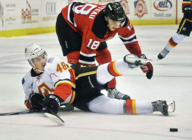 Adirondack Flames' #48 Bryce Van Brabant, left, Devils' #18 Stefan Matteau tangle as they chase the puck during the Flames' franchise opener Saturday Oct. 11, 2014, in Glens Falls, NY.  .(John Carl D'Annibale / Times Union) Photo: John Carl D'Annibale / 10028978A