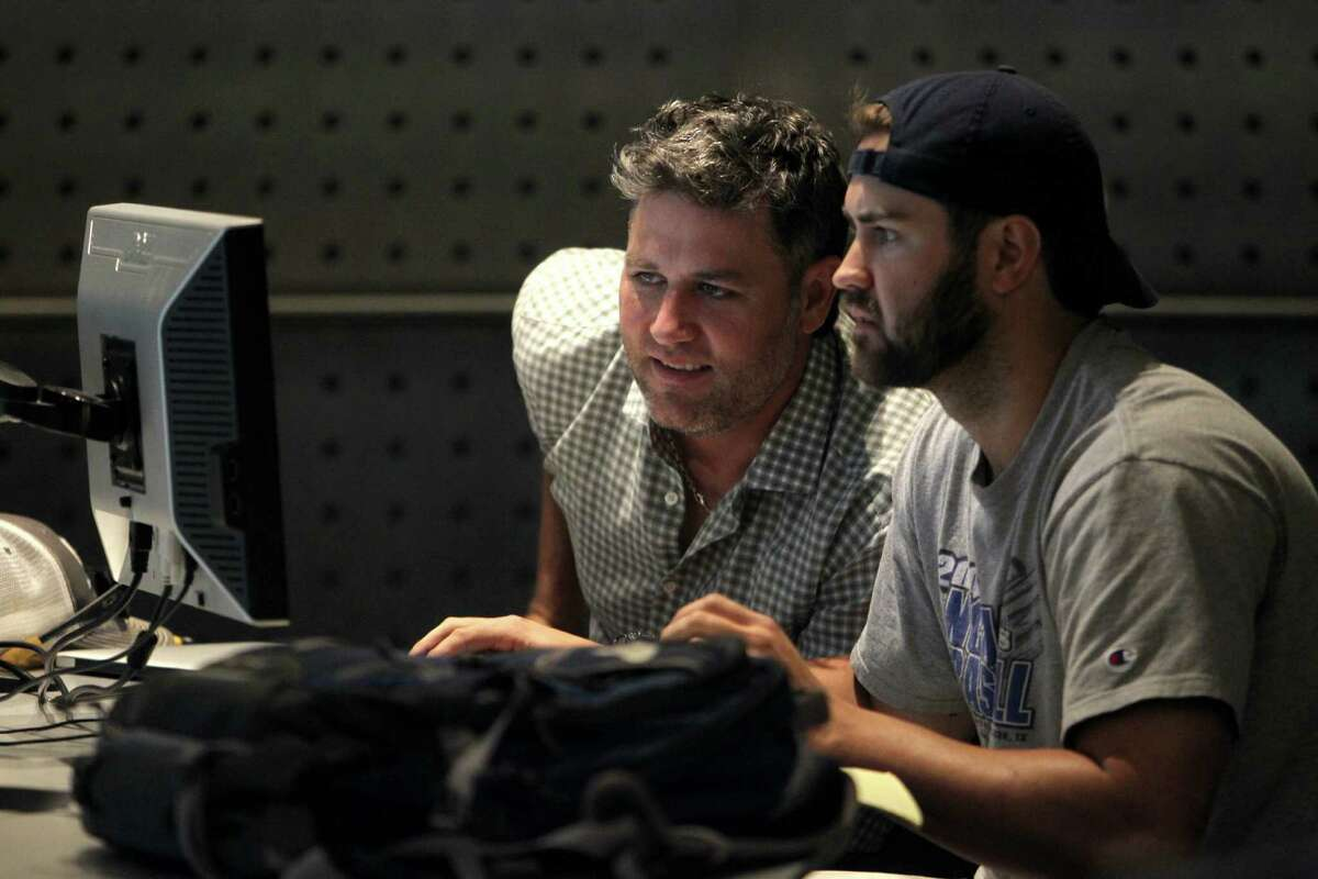 Lance Berkman, left, and Taylor Wall put their heads together during a study lab at Rice.