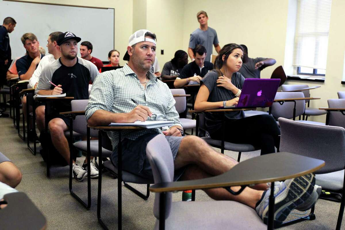About twice the age of his class peers, the 38-year-old Berkman takes up almost twice as much space as he gets comfortable in his new role as student. He's pursuing a degree in kinesiology at Rice.