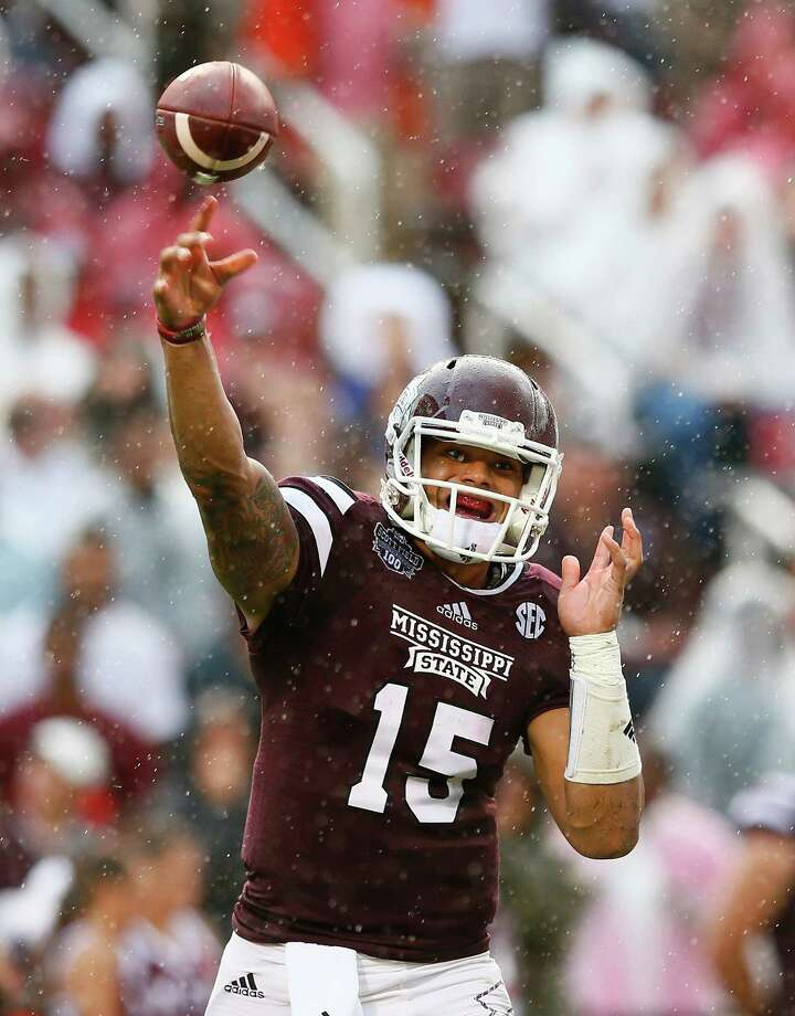 STARKVILLE, MS - OCTOBER 11:  Dak Prescott #15 of the Mississippi State Bulldogs passes against the Auburn Tigers at Davis Wade Stadium on October 11, 2014 in Starkville, Mississippi.  (Photo by Kevin C. Cox/Getty Images) ORG XMIT: 513032647 Photo: Kevin C. Cox / 2014 Getty Images