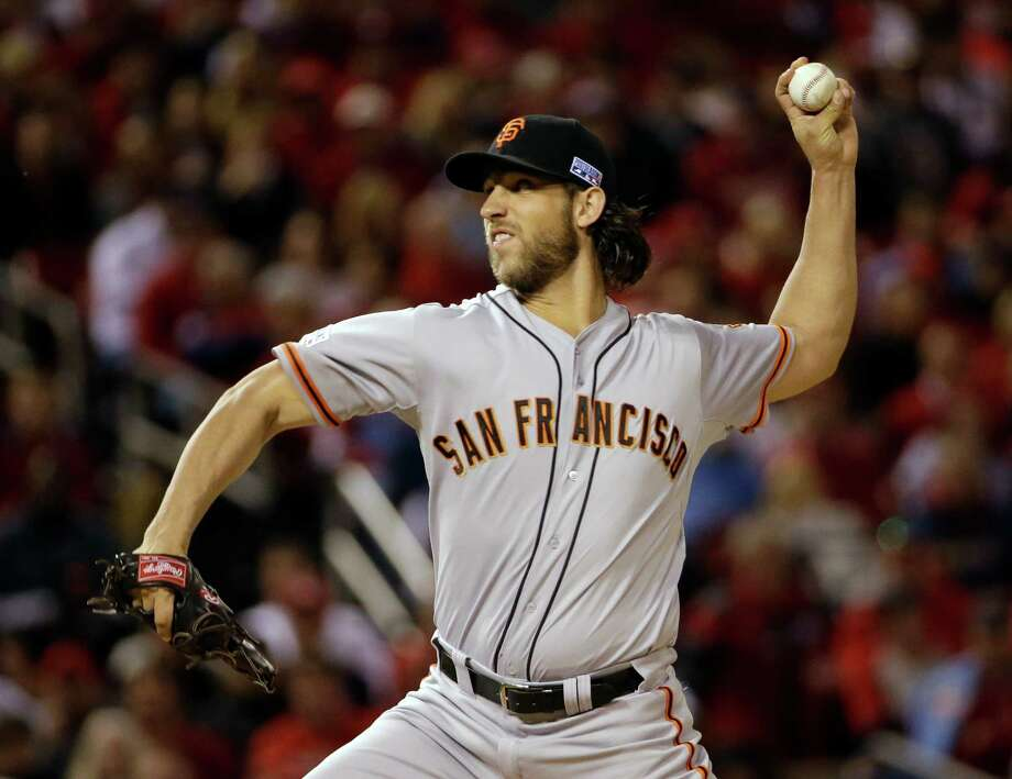 San Francisco Giants starting pitcher Madison Bumgarner throws during the first Game 1 of the National League baseball championship series against the St. Louis Cardinals Saturday, Oct. 11, 2014, in St. Louis. (AP Photo/David J. Phillip)  ORG XMIT: NLCS131 Photo: David J. Phillip / AP