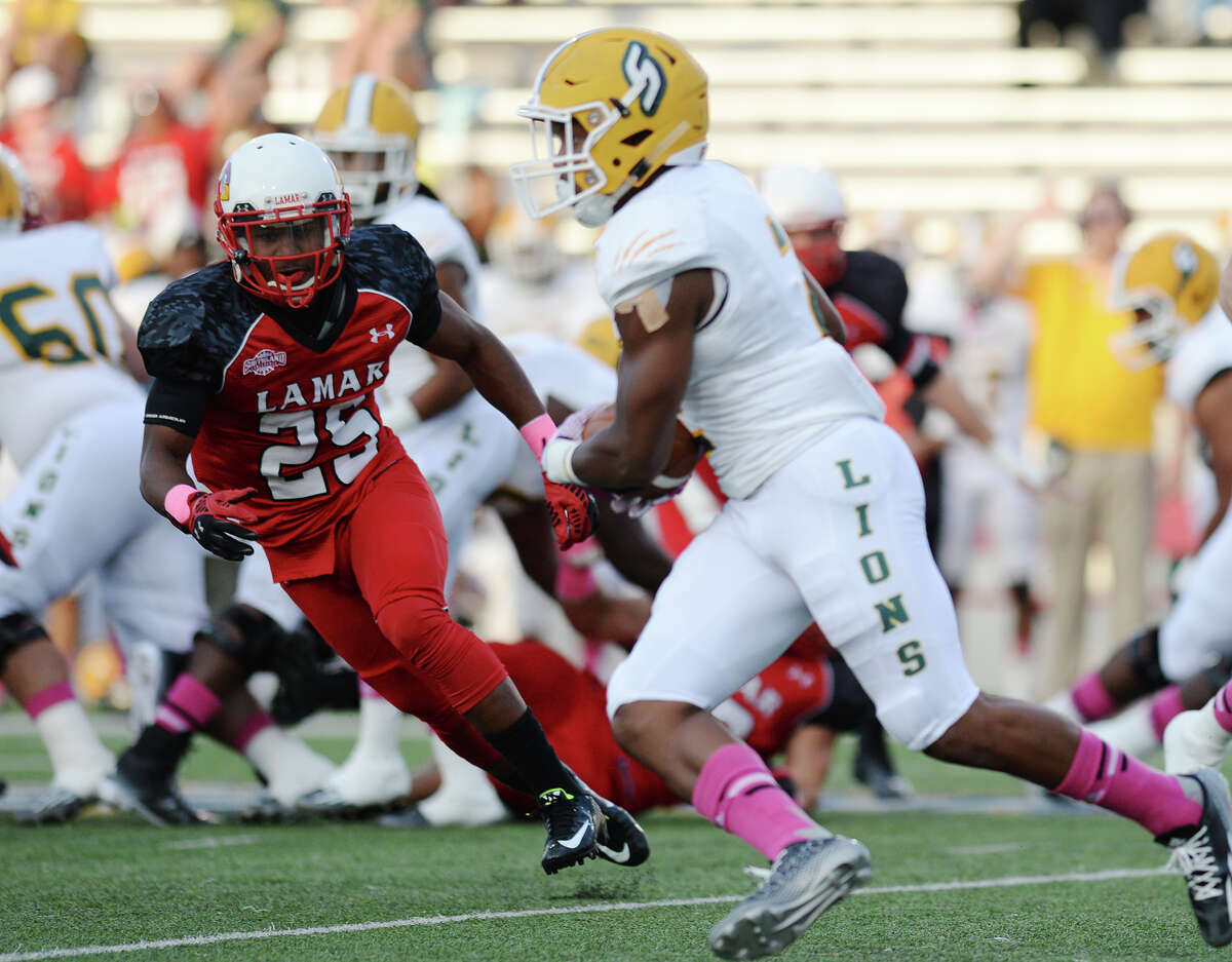 Lamar's Tommie Barrett, No. 25, closes in on Southeastern Louisiana University's Rasheed Harrell, No. 2, on Saturday. The Lamar Cardinals hosted the Southeastern Louisiana University Lions at Provost Umphrey Stadium on Saturday night. Photo taken Saturday 10/11/14 Jake Daniels/@JakeD_in_SETX