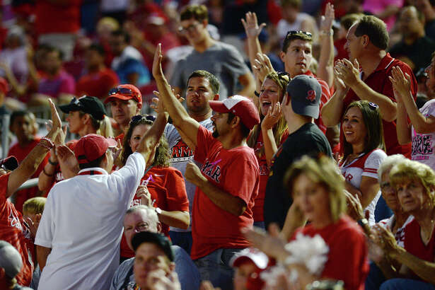 Lamar fans celebrate a touchdown during Saturday's game against Southeastern Louisiana University. The Lamar Cardinals hosted the Southeastern Louisiana University Lions at Provost Umphrey Stadium on Saturday night. Photo taken Saturday 10/11/14 Jake Daniels/@JakeD_in_SETX