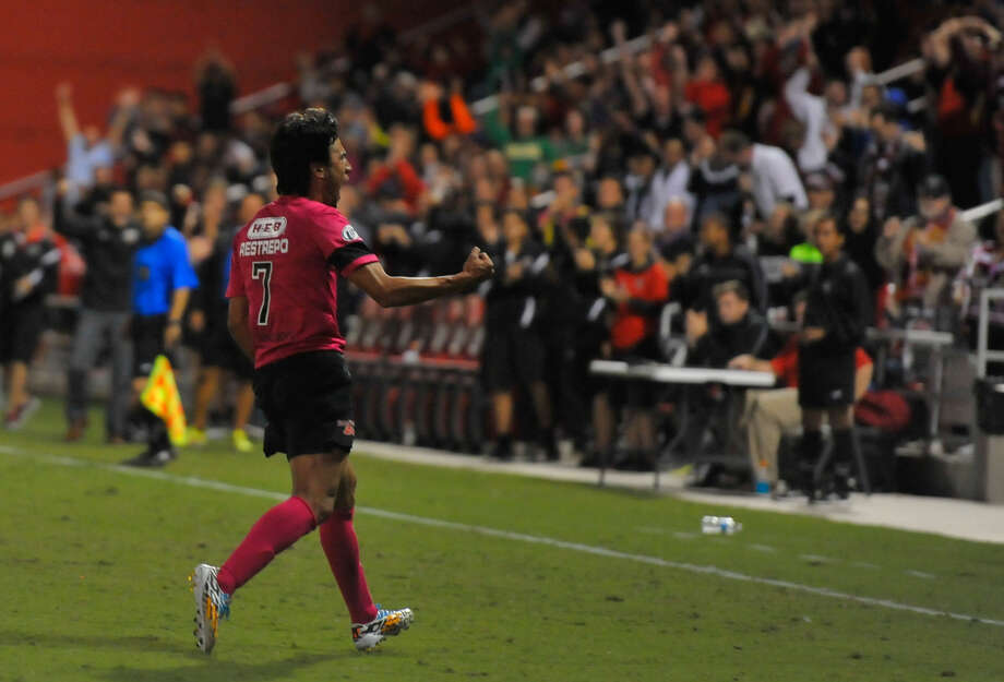 Walter Restrepo celebrates a goal Saturday. Rafa Castillo and Eric Hassli scored two goals apiece as the Scorpions extended their lead over third-place New York by six points with three matches left. Photo: Robin Jerstad / For The Express-News