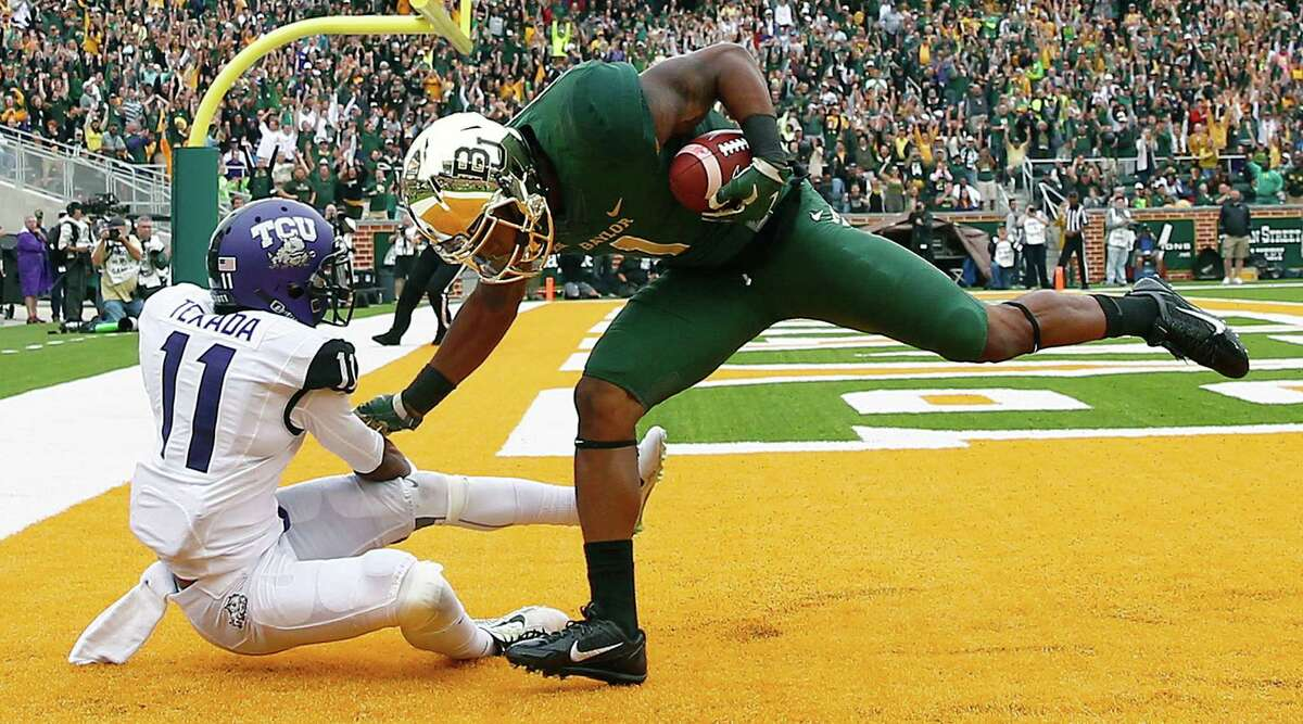 Baylor's Corey Coleman (right) scores a touchdown on TCU's Ranthony Texada at McLane Stadium in the highest-scoring game ever between top-10 teams.