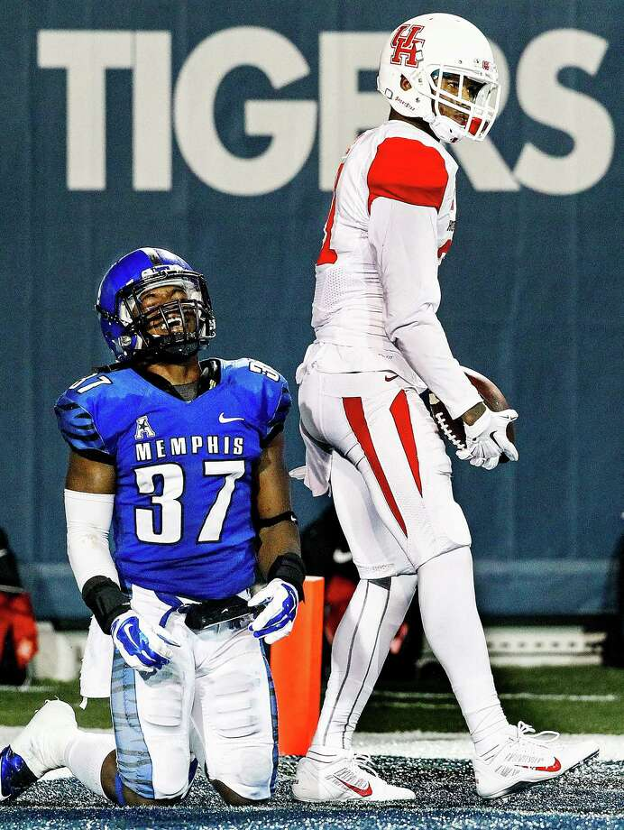 Dejected Memphis defensive back Bakari Hollier (left) reacts after giving up a touchdown pass to Houston's Markeith Ambles (right) during second half action of a college football game on Saturday, Oct. 11, 2014 in Memphis, Tenn. (AP Photo/The Commercial Appeal, Mark Weber) Photo: Mark Weber, Associated Press / The Commercial Appeal