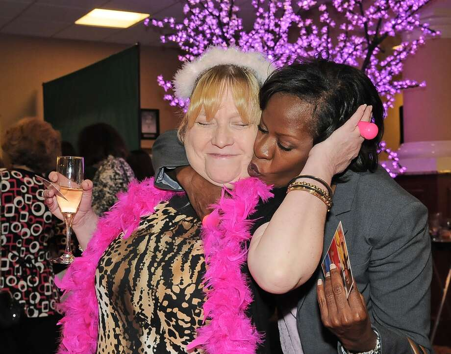 Cindy Mixon  is greeted by friend Erika Green  before the start of the 8th annual Project Pink fundraiser at North Cypress Medical Center in Houston, Texas Saturday October 11, 2014. Photo: Copyright Tony Bullard 2014, Freelance Photographer / Copyright 2014 Tony Bullard & the Houston Chronicle