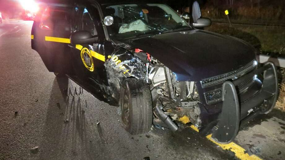 A State Police trooper vehicle was damaged in a crash on the Exit 8 off ramp on I-90 early morning Sunday, Oct. 12, 2014. Police charged the driver of the other vehicle, which was driving the wrong way on the ramp, with aggravated DWI. (Photo Thomas Heffernan Sr.) Photo: Picasa