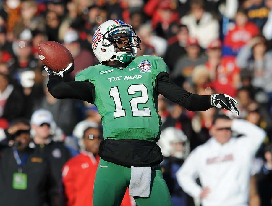 FILE - In this Dec. 27, 2013, file photo, Marshall's quarterback Rakeem Cato throws in the first half of the Military Bowl NCAA college football game against Maryland in Annapolis, Md. This year, Marshall, which joined Conference USA in 2005, is the preseason favorite. (AP Photo/Gail Burton, File) Photo: Gail Burton, Associated Press