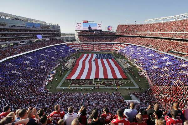 A field-sized flag adorns the field of Levi's Stadium during the National Anthem in a pregame ceremony before the 49ers played the Chicago Bears at Levi's Stadium in Santa Clara, Calif., on Sunday, September 14, 2014.