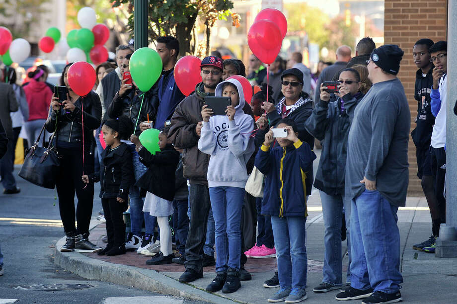 Onlookers watch as the Columbus Day Parade makes its way through downtown Stamford, Conn., on Sunday, Oct. 12, 2014. Photo: Jason Rearick / Stamford Advocate