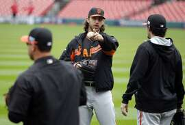 Pitcher Madison Bumgarner gets ready to throw during a light workout as the San Francisco Giants prepare to take on the St. Louis Cardinals in game two of the National League Championship Series, at Busch Stadium in St. Louis, Mo. on Sunday Oct. 12, 2014.